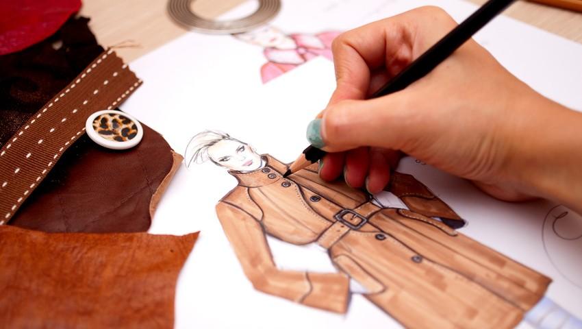 Fashion designer is drawing a fashion sketch for autumn-winter season